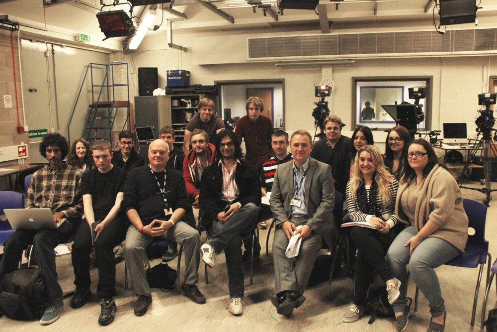 Award winning filmmaker Khurrum M.Sultan with Media lecturer Phil Middleham (L) and Curriculum Area Manager Simon O'Grady (R) and a group of media studies students.