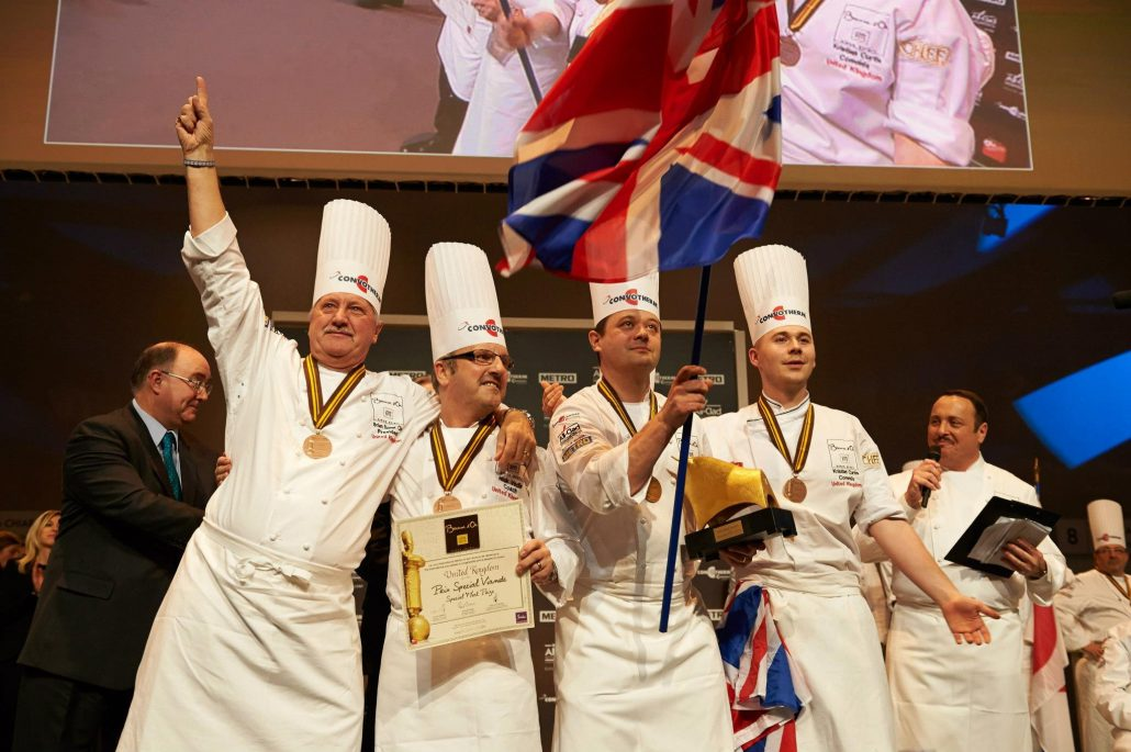 Kristian Curtis (fourth chef from the left) celebrating on stage with his teammates.