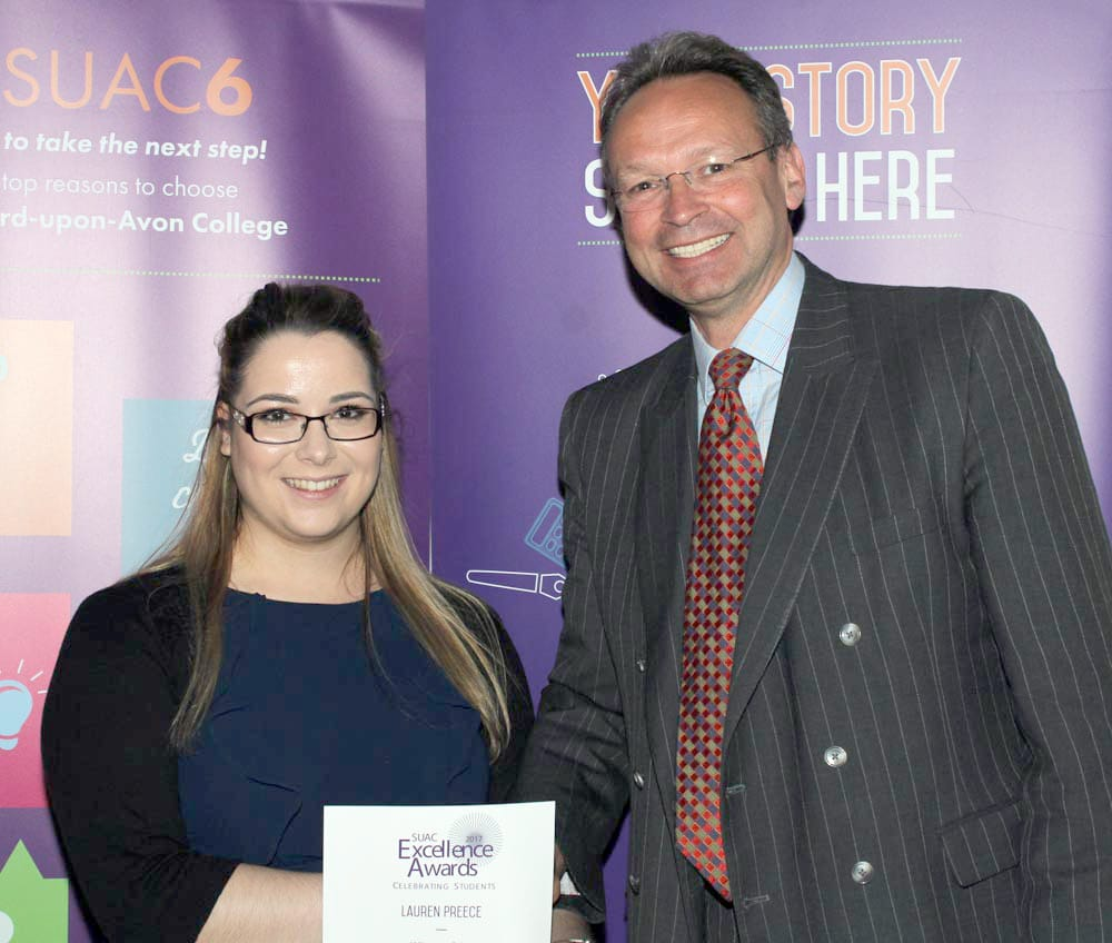 Business Support Apprentice Lauren Preece congratulated by College Principal and CEO Andrew Cropley.