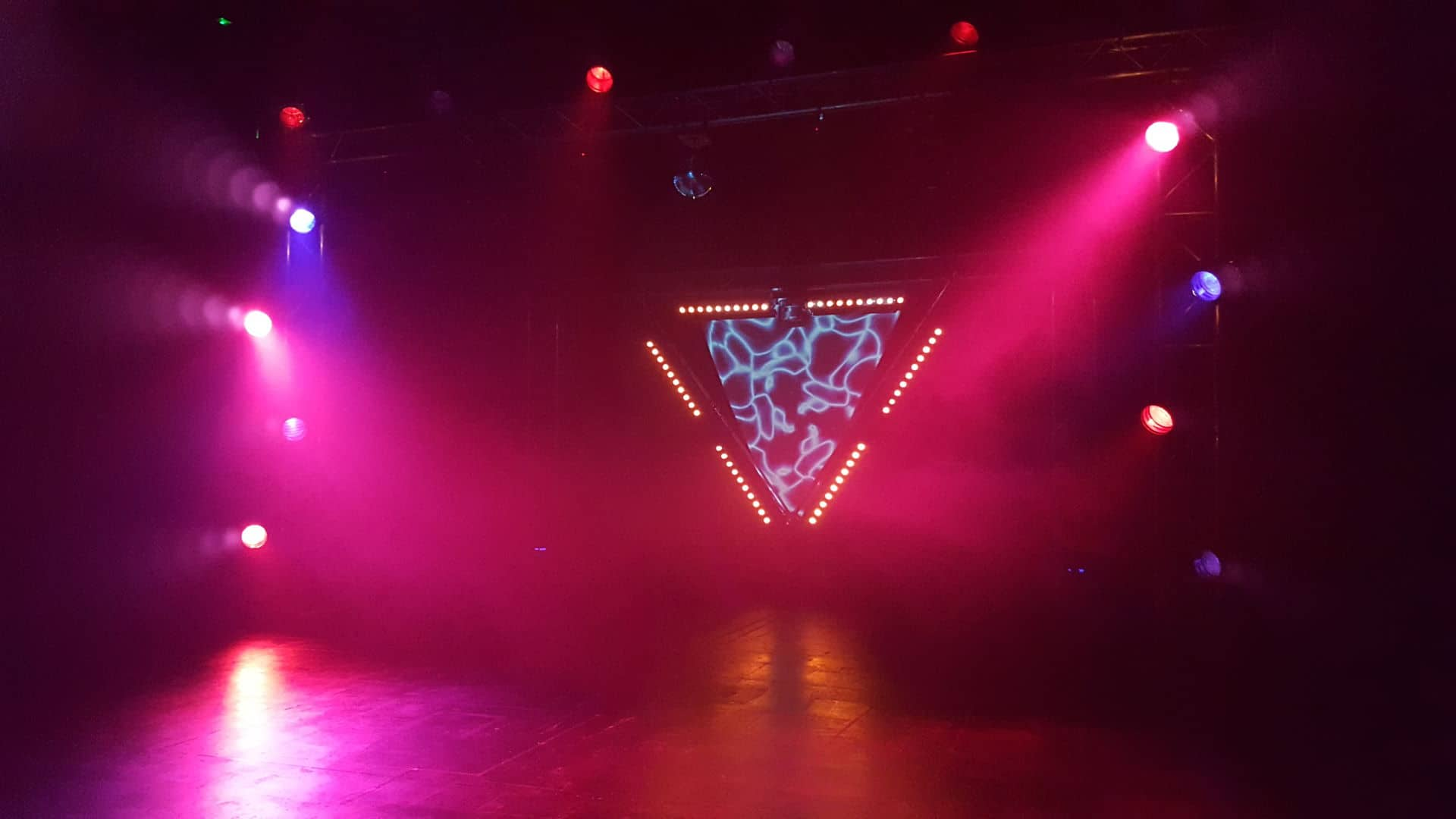 Stage lit with coloured lighting.