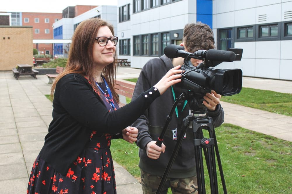 Sarah Downing helping students with filming