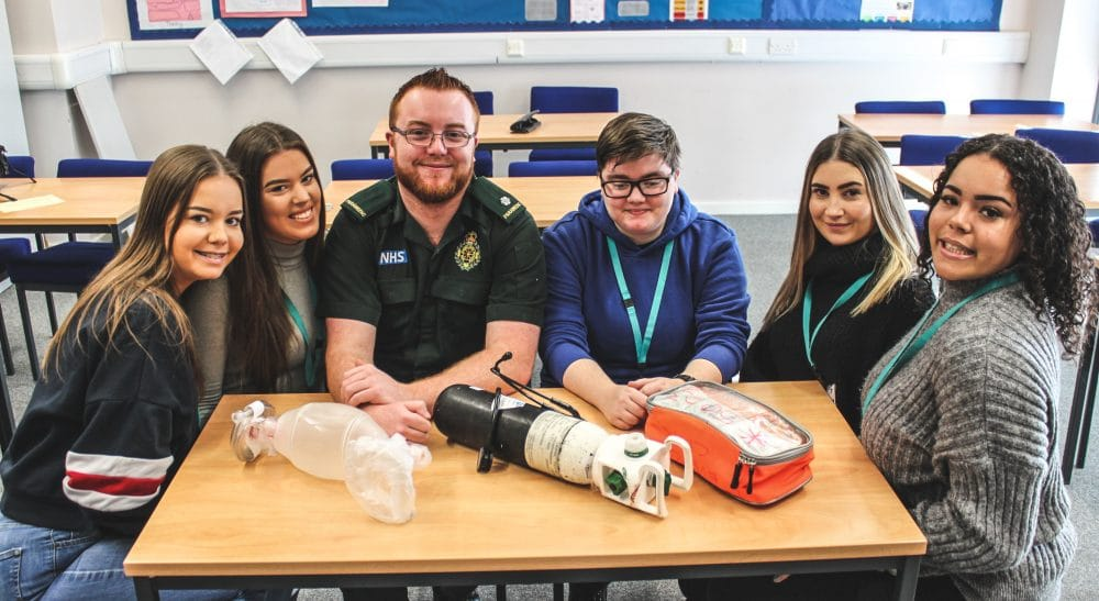 Paramedic James Barry (third from left) with Health & Social Care students (left to right) Chelsea Stokes, Millie Timmins, Ethan Meddoms, Ellie Campbell and Nurell Carter