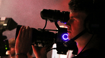 Student operates video camera.