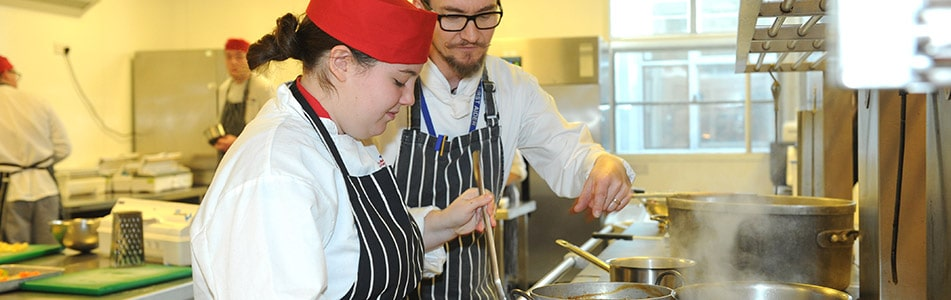 Catering college student with teacher
