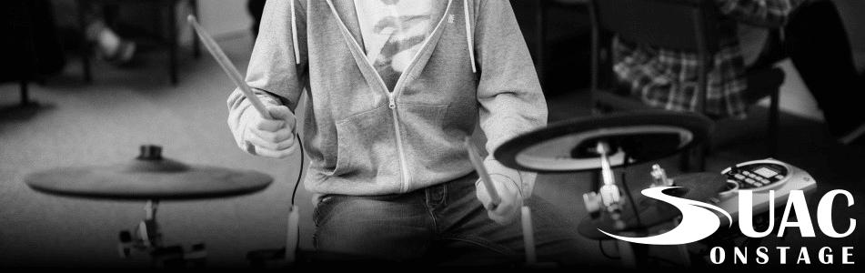 suac onstage performing drummer