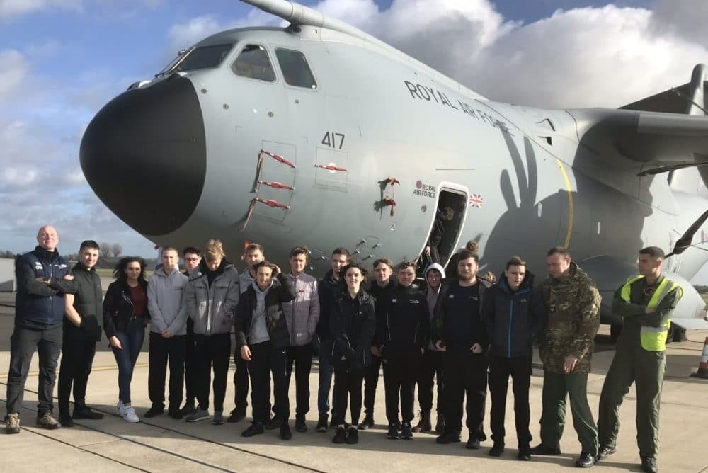 UPS students with RAF plane