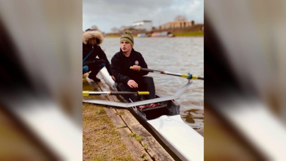 Student sat in boat holding oars