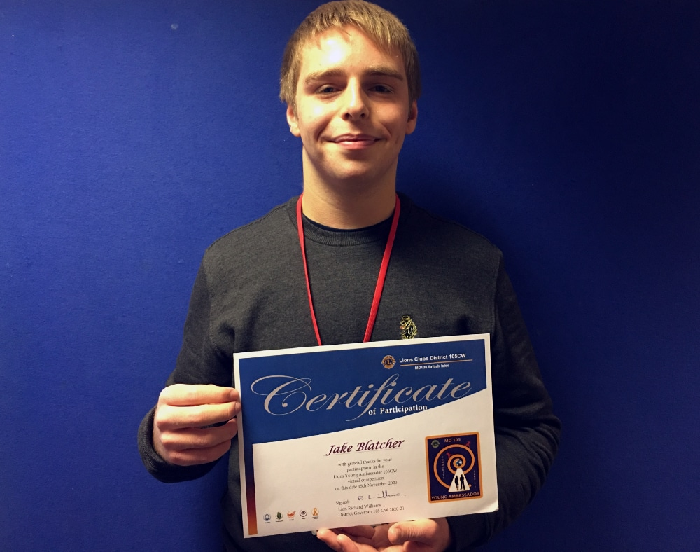 Student standing and holding certificate