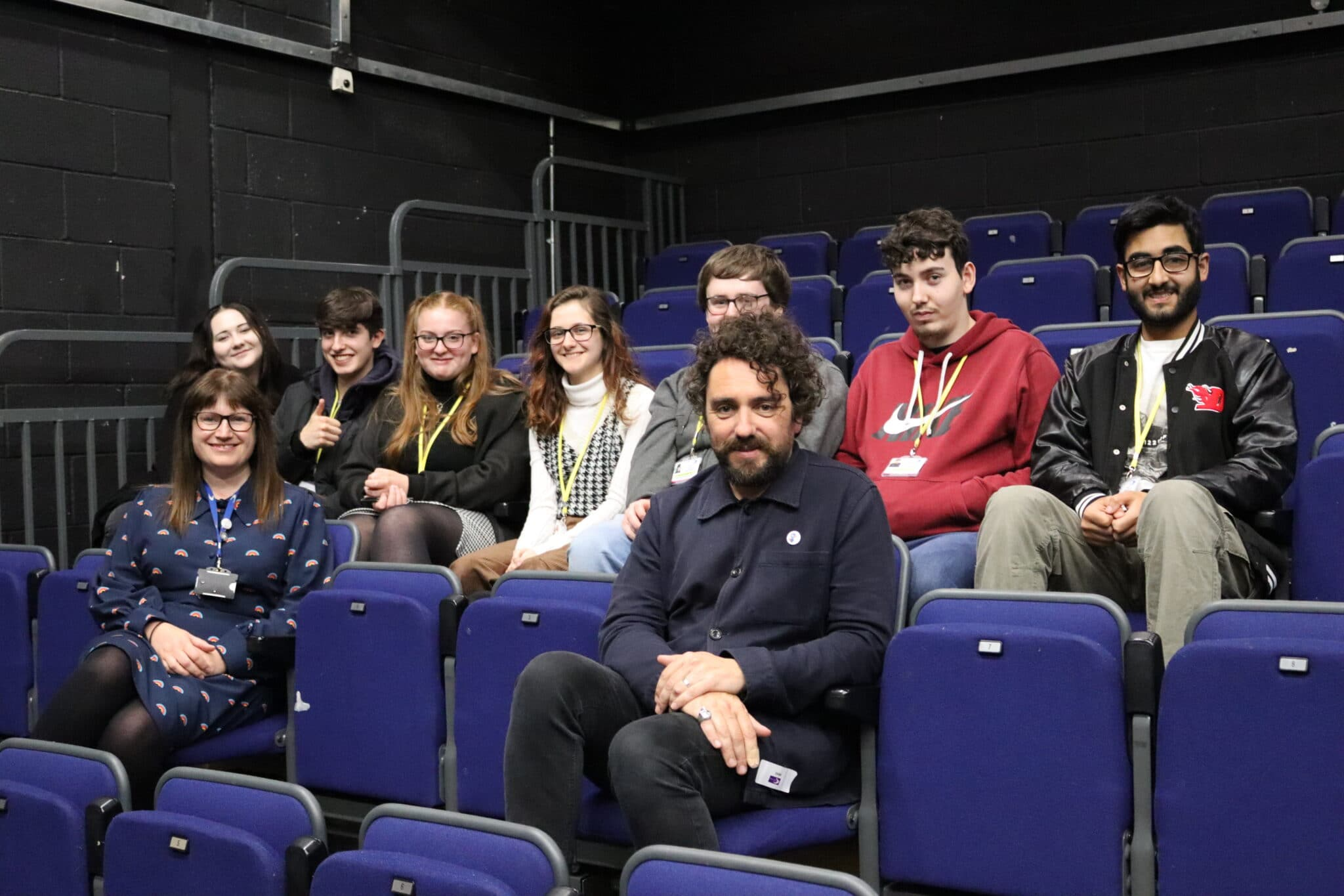 Greg McLeod sitting with students and tutor
