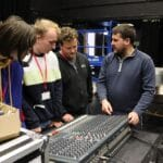 John with students at a sound desk